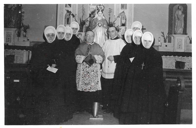 <p>The Sisters of Providence were summoned in 1946 by Monsignor Coudert, Roman Catholic bishop from France. He asked them to set up a Catholic education system in Whitehorse in response to the population increase associated with the construction of the Alaska Highway. The following year, the Christ the King convent and school opened on the corner of 4th Avenue and Wood Street where 55 sisters taught until 1981.<br /><br />Photo: Sisters of Providence with Monsignor Coudert<br />Photo credit: Yann Herry Collection</p>