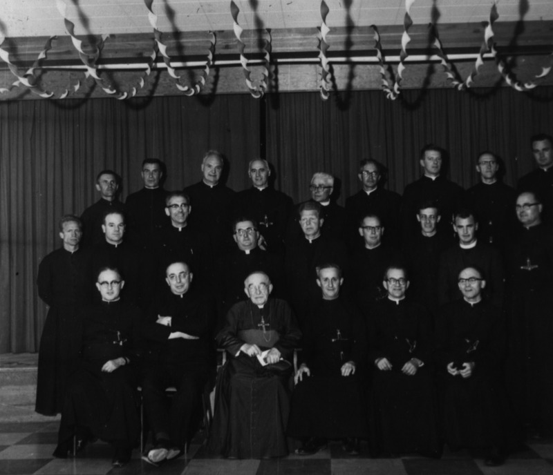 When the Diocese of Whitehorse Sacred Heart Cathedral was created in the early 1940s, Bishop Coudert recruited French-speaking religious OMI missionaries to serve the faithful throughout the territory and not just those who had access to the church. The priests and brothers he recruited served in Yukon communities up until 2013.<br /><br />Photo: Bishop Coudert and Oblates of Mary Immaculate, 1965<br />Photo credit: Yann Herry Collection