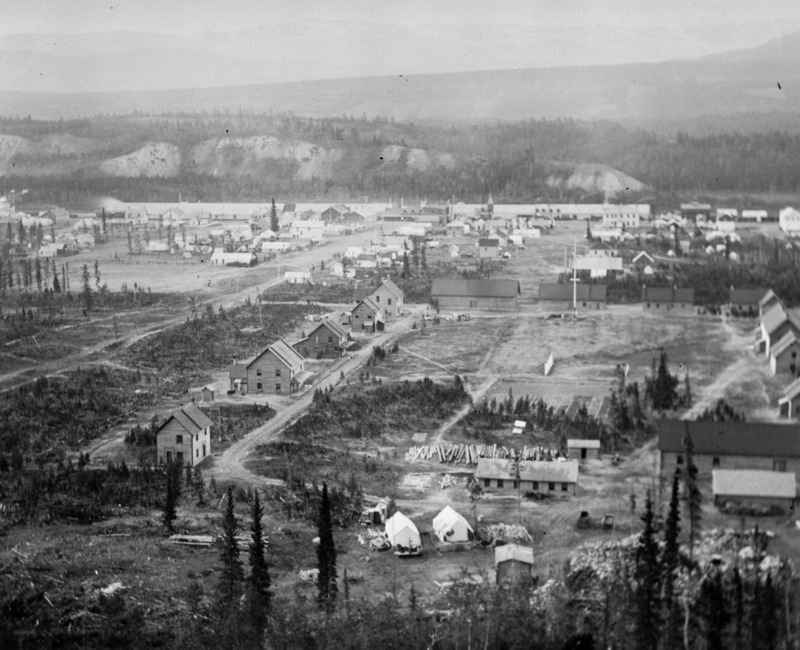 <p>If the spirit moves you, walk along the bluff, turning left at the stop of the stairs. You will have a spectacular view of Whitehorse, and see how much it has changed since this photograph was taken at the turn of the 20th century.<br /><br />Photo: Whitehorse seen from the bluff at the turn of the 20th century<br />Photo credit: fonds Ernest Brown, Yukon Archives , #891</p>