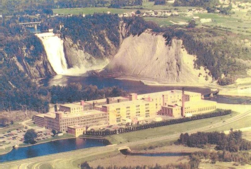 <p>Throughout the 19th century, a number of industrial players became established in C&ocirc;te-de-Beaupr&eacute;. One of the first was the Patterson-Hall sawmill, named after British entrepreneur Peter Patterson and his son-in-law George Benson Hall. The sawmill, founded at the foot of Montmorency Falls, was active from 1811 to 1892. In spite of the decline of the lumber industry at the end of the 19th century, the power generated by the falls continued to attract manufacturers, and a cotton cloth factory was built on the old mill site by Dominion Textile, which would carry on operations for nearly a century, until 1985.<br /><br />Photo: Dominion Textile at the foot of Montmorency Falls (coll. of the Centre de g&eacute;n&eacute;alogie, des archives et des biens culturels de Ch&acirc;teau-Richer)</p>