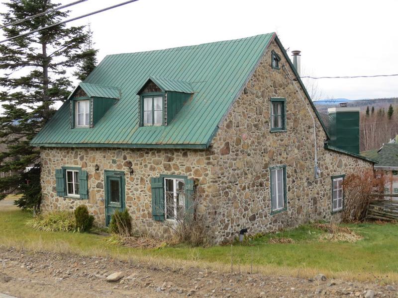 <p>The oldest houses in Saint-Tite-des-Caps date to the end of the 19th century. These Quebec-style homes were built on a fieldstone foundation that elevates them compared to the older houses found in C&ocirc;te-de-Beaupr&eacute;. They feature a wooden structure and a shingle or stucco exterior.<br /><br />Picture: Fieldstone house in Saint-Tite-des-Caps (Bergeron Gagnon inc, 2015. Inventaire du patrimoine b&acirc;ti de la MRC de La C&ocirc;te-de-Beaupr&eacute;)</p>