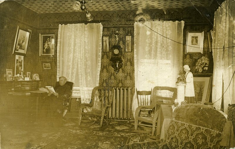 Priest Joseph-Georges Goudreau inside Saint-Alphonse Presbytery in the early 1900s.<br /><br />Picture source: CART - Fonds Galerie de nos anc&ecirc;tres de l&#39;or blanc