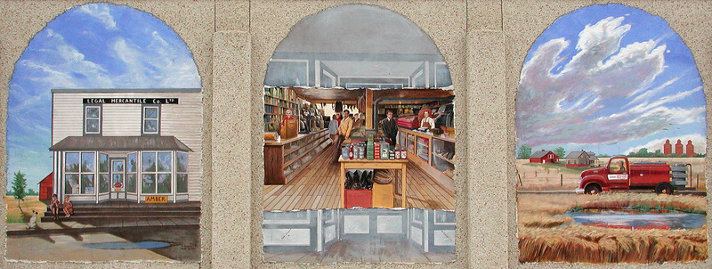 Mural by Remie Genest<br /><br />In 1924, eight entrepreneurial farmers, a lawyer, and a merchant founded Legal Co-op. It began with $201.88. During its baby years, Co-op sold petroleum products to the area&rsquo;s farmers. When Co-op bought Legal Mercantile (left panel) from Edmond Dozois in 1926, the business added general merchandise. The mural portrays the many people who worked there for a number of years.