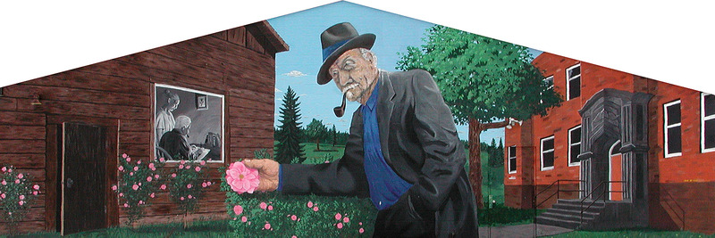 Mural by Marc and Daniel Michaud<br /><br />Th&eacute;r&egrave;se Bugnet roses appear all over the mural &mdash; the creation of this rose is one of the crowning achievements of George Bugnet. Look closely and notice how the top part of the stems of the roses have no thorns. On the left is Bugnet&rsquo;s first house. Looking through the window, we see George hard at work writing one of his books with his wife, Julia, offering her support. On the right is l&rsquo;&Eacute;cole George et Julia Bugnet (the George and Julia Bugnet School), which led to a Supreme Court decision on minority-rights education.