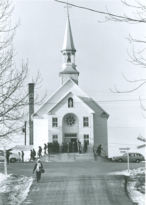 In May 1899, while thinking of the possible passage of the railway, the Oblates, helped by some workers from Pointe-Bleue, began building the church a little higher than the chapel.&nbsp;<br /><br />The population of the community (Pekuakamiulnuatsh) and the neighbors are active for its edification. Some organize bazzars to collect donations; others buy objects for worship or decorative items themselves.&nbsp;