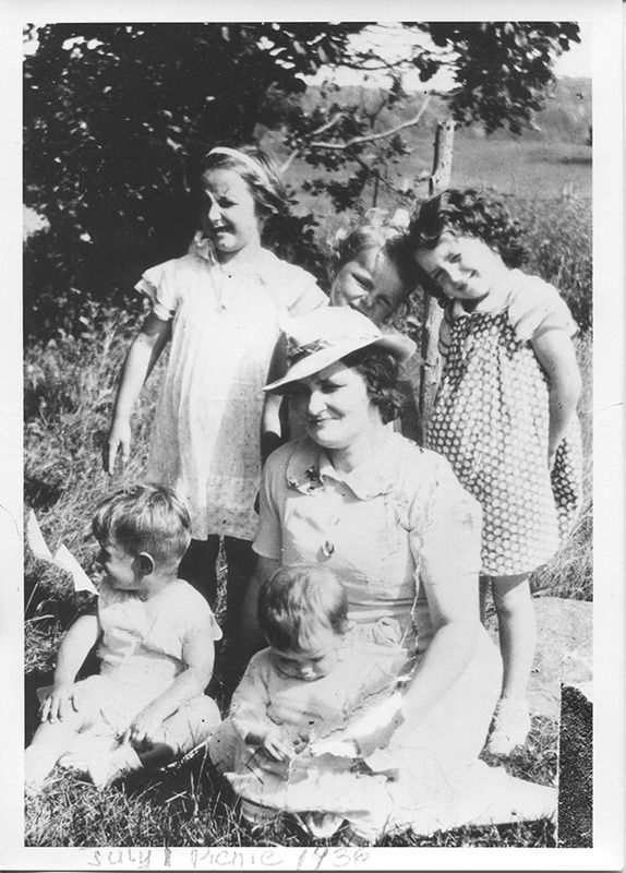<p>The Hicks family enjoying the annual 1st of July picnic, on church grounds. (July 1, 1936)</p>