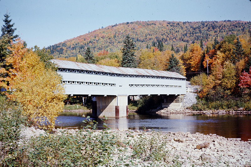 <p>A few kilometers from here, the road crosses the Jacques-Cartier river again. A covered bridge was built in the winter of 1939-1940. It burnt in 1972 and the current bridge was built in 1975.</p>