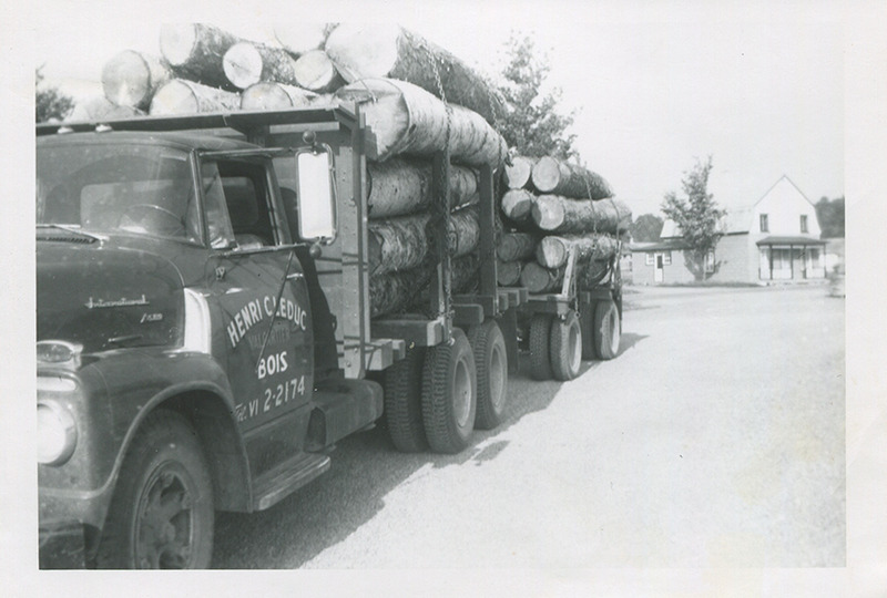 <p>Loaded truck parked at &#39;H.C. Leduc Lumber&#39; and the Pageau store in the background. (1954)</p>
