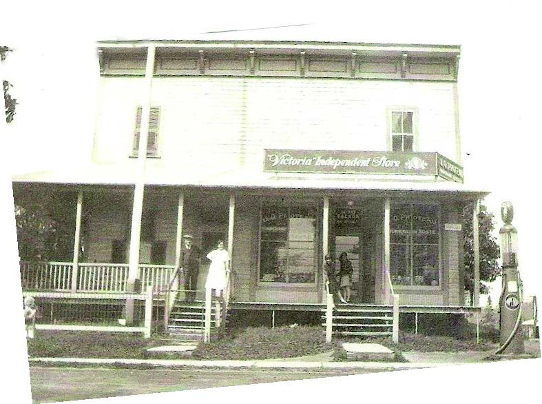 2988 Rolland Street<br /><br />The first postmaster Joseph-Ovila Proteau took possession of the house now located at 2988 Rolland Street. It served both as a general store and post office. He remained postmaster until 1972 in the house across the street (2989). Doctor Villemaire also resided in this house.<br /><br />At the time, the general store was inspired by the New England building style. The store occupied the ground floor with windows overlooking the street. The overhanging cornice with corbels included a covered porch. The wood planks were installed vertically.<br /><br />Credit:&nbsp;Soci&eacute;t&eacute; d&rsquo;histoire et de g&eacute;n&eacute;alogie des Pays-d&rsquo;en-Haut