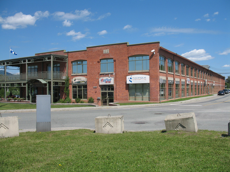 In honour of the history of the industry in Magog, the building is now called the Place du Moulinier.