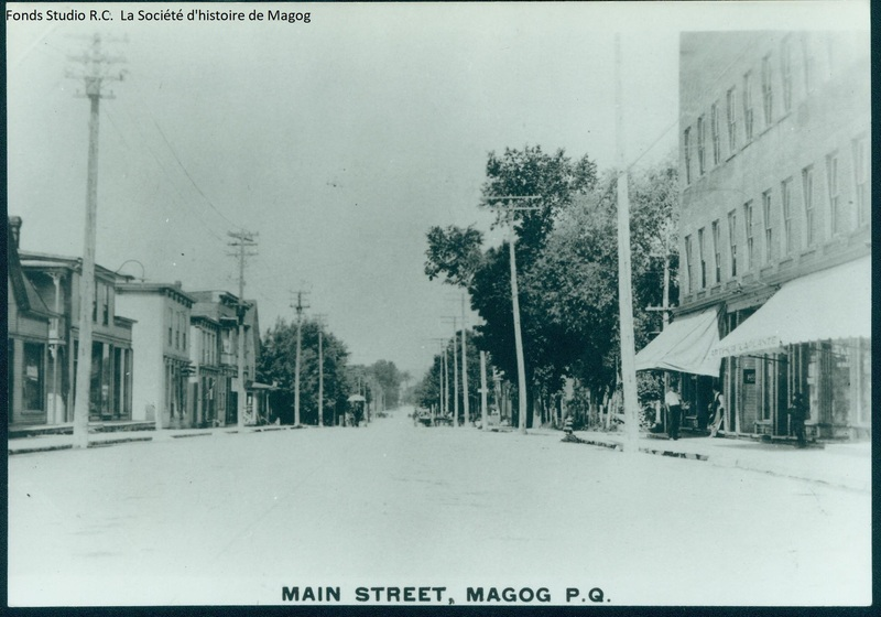 Principal street with Magog Opera house on the right in 1925.