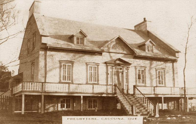 <p>The presbytery around 1900.<br /><br />Between 1835 and 1841, Cur&eacute; Edouard Quertier supervised the stonemasons and carpenters hired to build a presbytery worthy of the parish. A solid stone building was erected on high foundations, with massive chimneys extending from the fire walls at either end.<br /><br />Photo source :<br />Richard Michaud Collection</p>