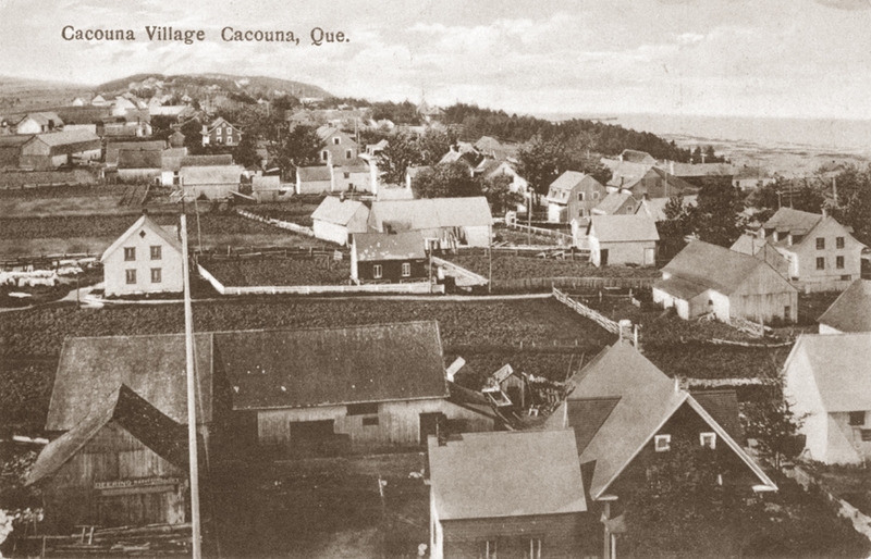 <p>A view over Cacouna from the church belfry, around 1900. In the foreground, the house and post office of notary Jean-Baptiste Beaulieu.<br /><br />The notary Jean-Baptiste Beaulieu (1842-1896) was a merchant who also served as postmaster and secretary-treasurer for the school board, parish and village of Cacouna. His home was across the street from the church, always bustling on Sundays, and not far from the shoemakers, Guerette et Fr&egrave;ve, and another merchant, Fran&ccedil;ois-Xavier C&ocirc;t&eacute;. People from Cacouna&rsquo;s five concession roads frequented his house, where, with help from two of his children, he had set up his notary office, a small store and the post office in 1854. His son Jean-Baptiste, also a notary by profession and the owner two schooners, the Marie-Rose (1873) and the Em&eacute;rillon (1874), supplied food for the store and helped out at the post office. His other son Thomas served customers in the store. In 1891, Thomas Dionne was hired as assistant postmaster. He was responsible for receiving, sorting and distributing the mail for Cacouna&rsquo;s residents and visitors.<br /><br />Photo source :<br />Postcard, Ernest Mercier, Richard Michaud Collection</p>