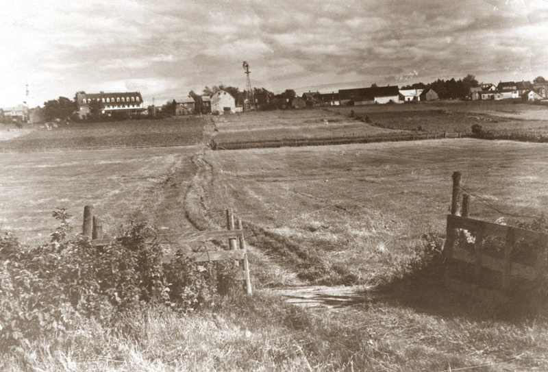 <p>Field of the Michaud farmland, early 20th Century.<br /><br />Guests at Cacouna House, built by Adolph Sirois in 1862, used a path through the Michaud property to go to the beach. As a boy, starting in 1886, the poet &Eacute;mile Nelligan was a frequent summer visitor:&nbsp; &laquo;The place where Nelligan felt truly at home and free as the air was the farm of Thomas Michaud, whose son Ulric often played the guide for the younger city kid as they roamed the surrounding fields and meadows. Several buildings, including Cacouna House and Mansion House, were later constructed on the land of this farm in the heart of the village.&raquo; (From : Au pays du porc-&eacute;pic, Paul Wyczynski, Nelligan &agrave; Cacouna, &Eacute;ditions Epik, page 26)<br /><br />Photo source :<br />Richard Michaud Collection</p>