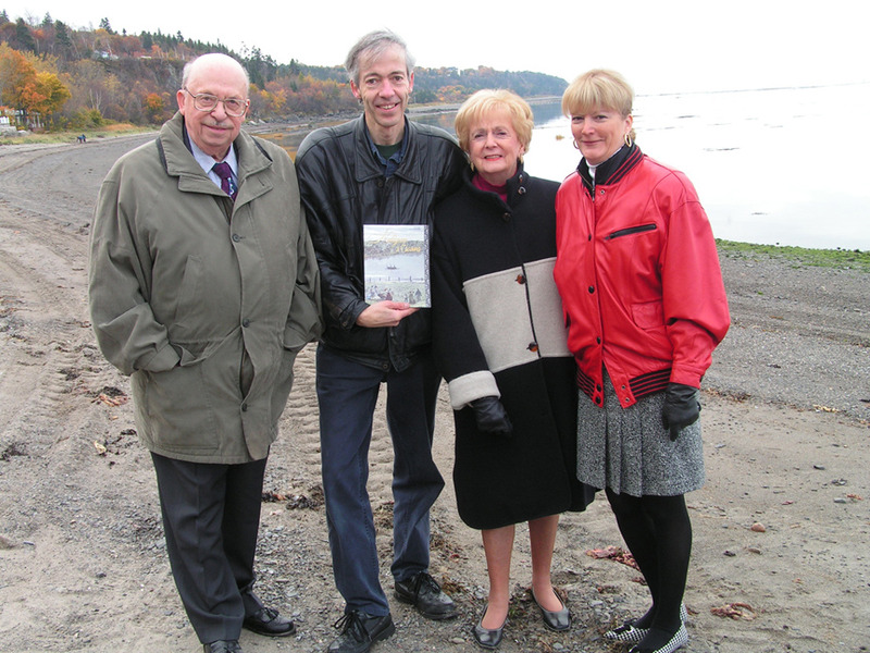 <p>Marielle Corbeil-Saint-Pierre, Nelligan&rsquo;s niece, second from right, on the beach of the Anse Fontaine Claire in October 2004, for the launch of the book &ldquo;Nelligan &agrave; Cacouna&rsquo;&rsquo;.<br /><br />Cacouna offered Nelligan a world of sounds, colours, scents, sensations unique to its maritime setting. Although a dark destiny awaited the poet &ndash; he entered an asylum in August 1899, a year after his last visit to Cacouna, and remained there until his death in 1941 &ndash; reports from those who visited him, including his niece Marielle, reveal that memories of his freedom-filled summers in Cacouna stayed with him throughout his life.<br /><br />&ldquo;For about a dozen years,&rdquo; says Marielle Corbeil-Saint-Pierre, Nelligan&rsquo;s niece, &ldquo;my father, &Eacute;mile Corbeil, took us to visit my uncle at the Saint-Jean-de-Dieu sanitorium. (...) In the course of conversation, my uncle &Eacute;mile sometimes talked about Cacouna: its hotels and gardens, a villa among the trees, and especially the ever-changing St. Lawrence, with its almost musical play of colours. He was pensive when he evoked the past. I noticed that his eyes were fixed on me. I felt he was reliving his youth with a secret fondness, confusing me with his younger sister Gertrude, my mother.&rdquo; (Nelligan &agrave; Cacouna, p.118-119)<br /><br />Photo source :<br />Source : Yvan Roy. From left to right: Paul Wyczynski, Yvan Roy, Marielle Corbeil-Saint-Pierre and her daughter Anne Saint-Pierre.<br />&nbsp;</p>