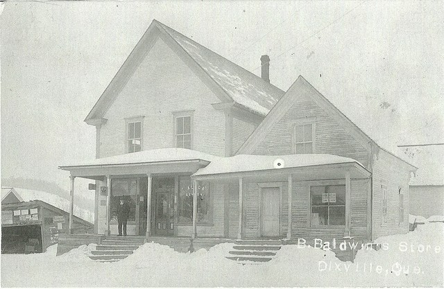 <p>Bruce Baldwin&#39;s store was situated on chemin Parker. He bought it from J. Mayhew in 1887. When he took on his son-in-law, T.J. Grady, as partner, the store was renamed Baldwin and Grady&#39;s Store. As well as selling clothing and groceries, the store comprised a smithy, a public telephone booth, post office, drugstore and a service counter for the Eastern Townships Bank.</p>
