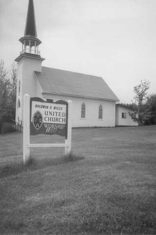 <p>Walter Belknap, together with John Fox, built the Baptist Church at the right-hand side of the Lakeside Cemetery on chemin Lyon. This church was destroyed in 1942. In 1888, The two men built the Methodist church at 1915 chemin May. This church is the present United Church.</p>