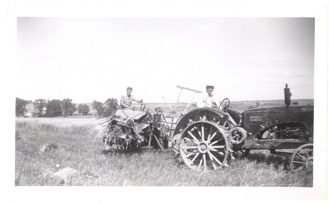 <p>Laur&eacute;at Lavoie drove the tractor, and his son Jacques took care of the harvester, in 1944-45.</p>