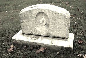 <p>One of the monuments of Ives Hill cemetery. The hand with a finger pointed to the sky: a symbol of power, of transcendence and of sacredness.<br /><br />Sources: <a href='http://www.mrcdecoaticook.qc.ca/fr/culture-loisir/documents/inventairecimetiere2.pdf'>R&eacute;pertoire des cimeti&egrave;res et des croix de chemin de la MRC de Coaticook.</a></p>