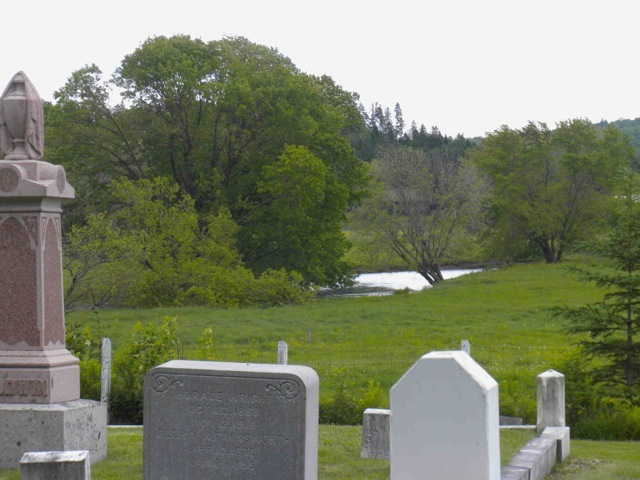 The Indian Stream Cemetery is located on Tabor Road in Pittsburgh, New Hampshire. The river can be seen in the background.<br />Jeremiah Tabor, who is buried in this small cemetery, was one of the pioneers of Indian Stream, along with Luther Parker, in 1832.