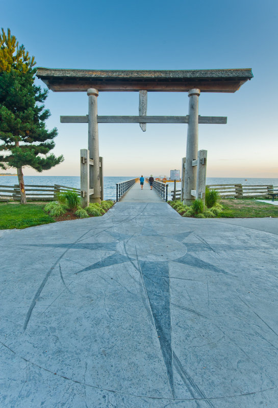 <p>LOCATION: near 5284 Wharf Ave. (pedestrian pier at Trail Bay)<br />SCULPTURE: Torii Gate, 2002<br />ARTISTS: Timber Framers Guild of North America<br />MEDIUM: Cedar<br /><br />A Torii Gate is a traditional Japanese gate, typically located at the entrance to a Shinto Shrine, marking the passage from the profane into the sacred.</p>