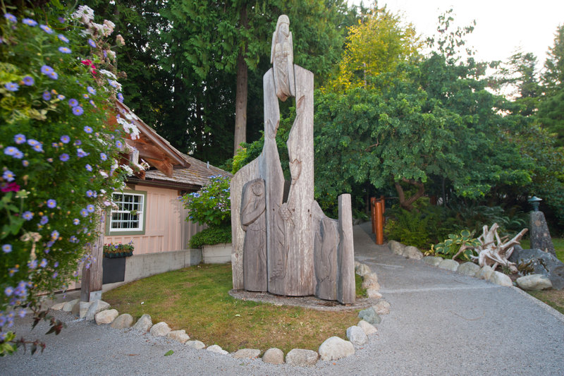 <p>LOCATION: Rockwood Gardens, 5511 Shorncliffe Ave.<br />SCULPTURE: Sanctuary, 1985<br />ARTIST: Dudley Carter<br />MEDIUM: Red cedar<br /><br />Dudley C. Carter (1891&ndash;1992) was a Canadian-born artist whose highly prolific career as a monumental woodcarver and sculptor spanned more than 60 years. Many of his works are on public display in various locations along the west coast of North America, particularly near his former home in Redmond, WA.<br />A few years after the artist passed away, this artwork was transported from California up to B.C. on behalf of the Hillside Industrial Park in Port Mellon.&nbsp; Due to security concerns, the sculpture was relocated to the Rockwood Gardens where it has remained ever since.</p>