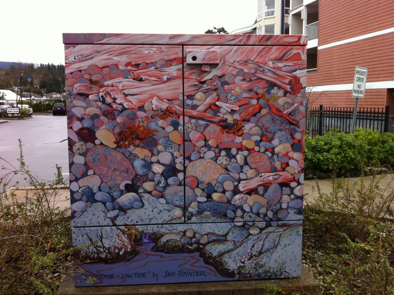 <p>LOCATION: near 5470 Inlet Rd.<br />MURAL: <em>Seastone &ndash; Lowtide</em>, 2009<br />ARTISTS: Jan Poynter<br />MEDIUM: Acrylic paint<br /><br />As part of a Sechelt Downtown Revitalization Plan, in 2008 the District of Sechelt and BC Hydro put out a call for artists to decorate a number of utility boxes. Local artist Jan Poynter was awarded the project, and &lsquo;driftwood&rsquo; was the theme selected. Each of the boxes depicts different &lsquo;phases&rsquo; of driftwood - from log boom, to stranded high tide logs, to small bits of driftwood among the stones. All of the painted utility boxes in this series are based on actual waterfront scenes in Sechelt.<br /><br />Jan Poynter studied Painting and Printmaking at the Vancouver School of Art (now Emily Carr University of Art Design) and continued in Art Education at the University of British Columbia. Poynter now works as a professional artist, illustrator, and art instructor in Gibsons, BC.</p>