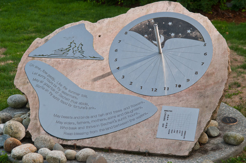 <p>LOCATION: Municipal Hall Sculpture Garden, Rosina Giles Way<br />SCULPTURE: <em>Summer</em> <em>Time</em>, 2009<br />ARTIST: George Pratt<br />MEDIUM: Granite and stainless steel<br /><br />A sundial for Sechelt was artist George Pratt&rsquo;s initial idea when proposing this sculpture. He was looking for a topical sculptural subject, and thought that the most fitting metaphor would be an artwork that both engages its viewers and is &lsquo;solar-powered&rsquo;. This is an equatorial sundial; this type best allows for originality in design, and can be constructed in a monumental size on a small budget.</p>