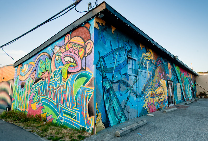 <p>LOCATION: 5549a Wharf Ave. (Six Gill Custom Tattoos building)<br />MURAL: Untitled, 2012<br />ARTISTS: Jordi &ldquo;J. Loca&rdquo; Ruiz (Spain), Nicole &ldquo;HUFF&rdquo; Stewart (Canada), Severino &ldquo;DOING&rdquo; Estevez (Spain) and Jesse Young (Canada)<br />MEDIUM: spray paint<br /><br />This mural was commissioned in 2012 by Jesse Young, owner of the Six Gill Custom Tattoo shop.&nbsp; He assisted three other artists to complete this vibrant and unique collaborative painting. Together the four artists worked for six days to complete the painting.</p>