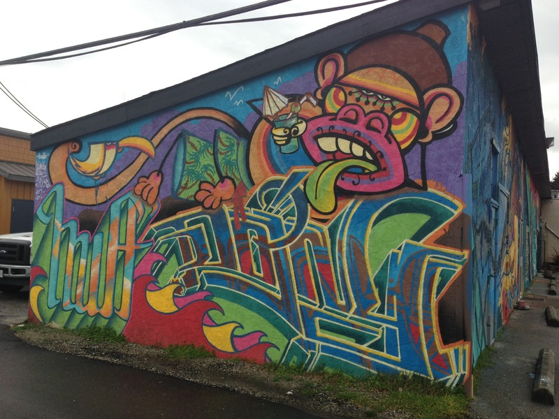 <p>Although the artists collaborated on each element, individual styles are still apparent. The wall facing Periwinkle Lane showcases the style of street artist Jordi &ldquo;J. Loca&rdquo; Ruiz. Included are his characteristic bright colours, bold lines, and cartoon-like animals (in this case a monkey and a bird). The monkey reclines at the top of the mural, wearing &lsquo;Hawaiian&rsquo; print shorts and holding a tropical drink in one hand. Beneath the monkey is the signature (known as a &lsquo;piece&rsquo; in graffiti painting) &ldquo;DOING&rdquo; (Severino Estevez), and in the lower left corner of the mural, beneath the bird, is another piece by &ldquo;Huff&rdquo; (Nicole Stewart).</p>