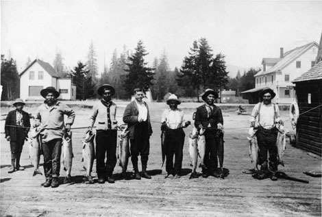 <p>This is the original photo that inspired the mural. Standing at the center (the man without a hat) is Thomas Patrick O&#39;Kelly. O&rsquo;Kelly moved his family to Sechelt in 1912 where he served briefly as postmaster and as a school trustee.<br /><br />Photograph courtesy the O&#39;Kelly family.</p>
