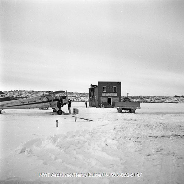 <p>Moving of the building in 1974.<br /><br />Photo source: NWT Archives/Henry Busse N-1979-052-5147.</p>