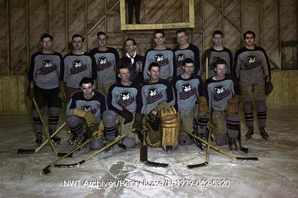 <p>Each large company used to have its hockey team in Yellowknife.<br /><br />Photo source: NWT ArchivesYellowknife Photograph CollectionN-2004-006 0064.</p>