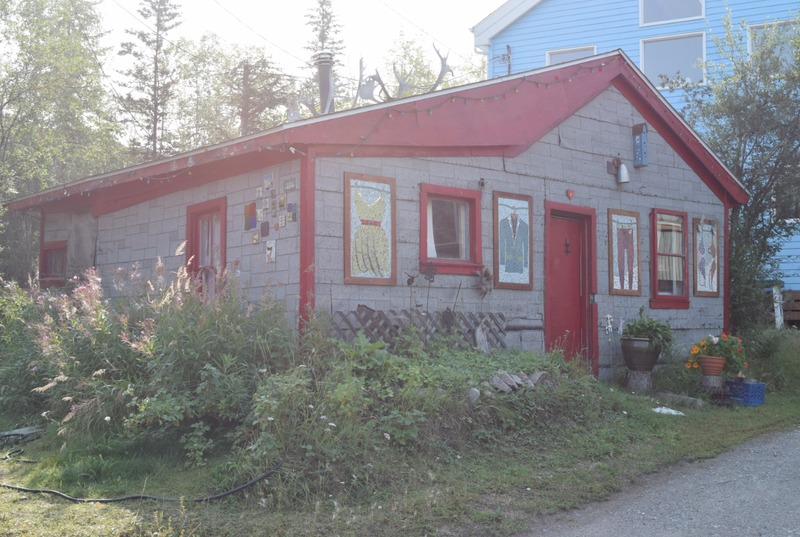 <p>Behind this grey house siding and pretty mosaics hides one of the oldest log buildings in Yellowknife.</p>