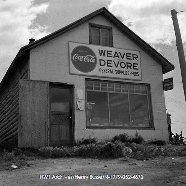 <p>After arriving in Yellowknife by barge from Peace River (Alberta) in 1936, Harry Weaver and Bob Devore founded the Weaver &amp; Devore shop. Photograph dating from the 1950s.<br /><br />Photo source: NWT Archives/Henri Busse/N-1979-052-4672.</p>